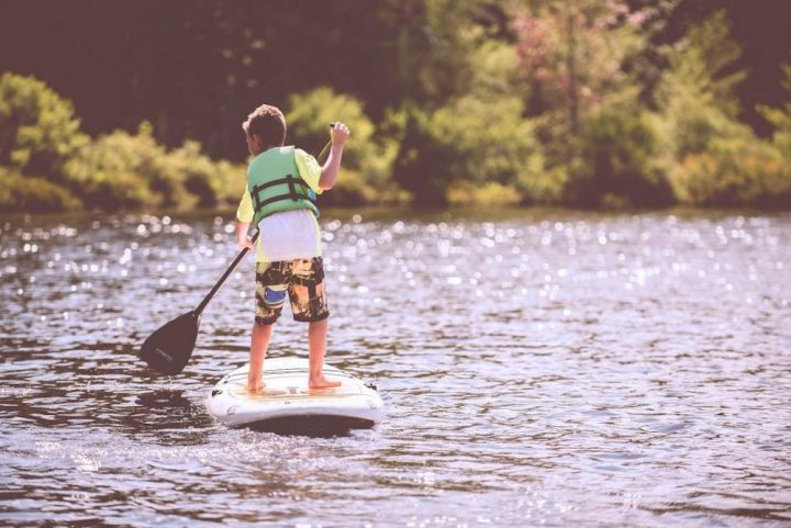 boy paddle boarding