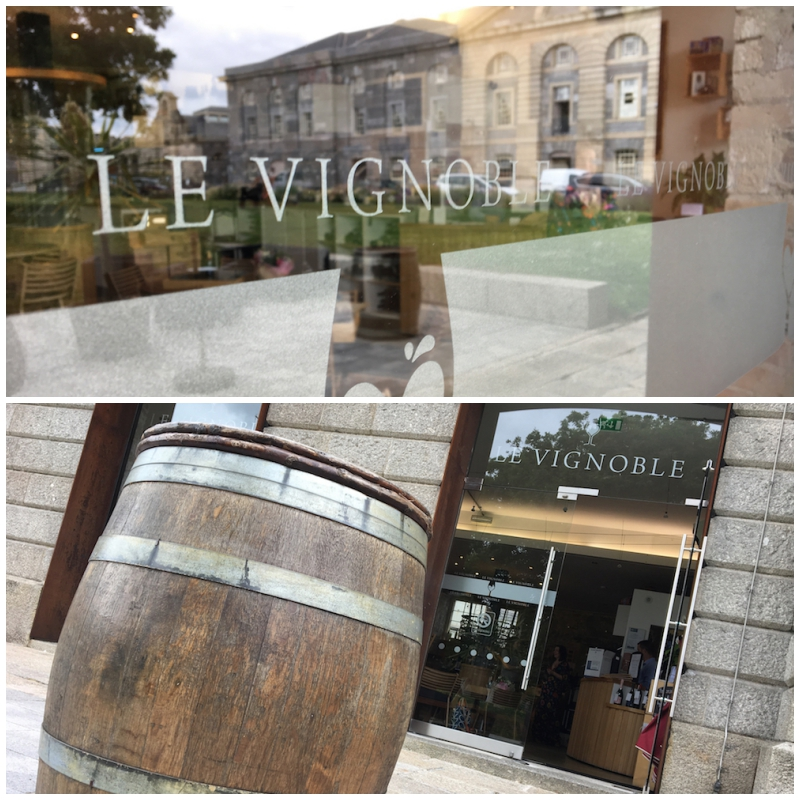 exterior of le vignoble wine merchant with wine barrels