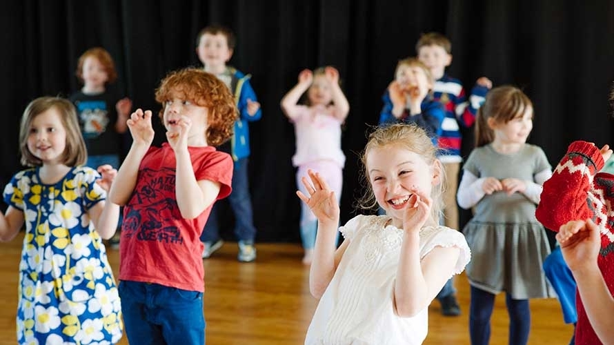 group of children taking part in performing arts