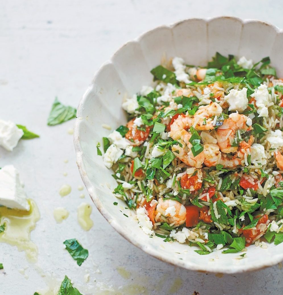 prawn, fennel and tomato pilaf with mint on white plate and white tabletop and olive oil