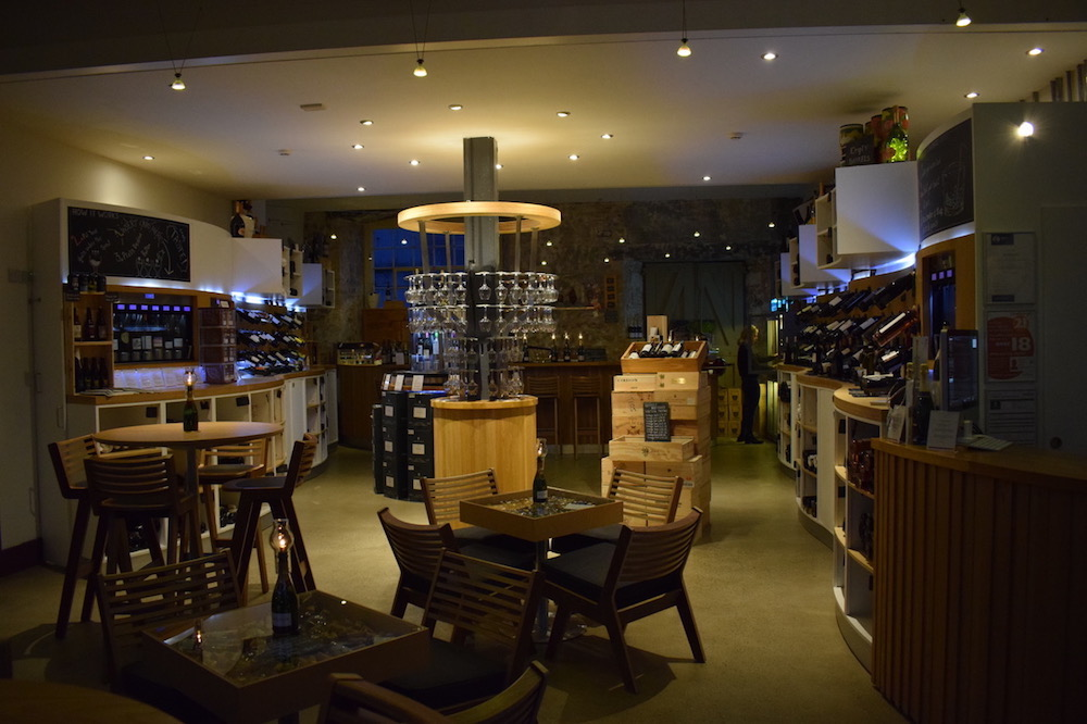 interior of lev ignoble wine lounge at night with wine serving systems