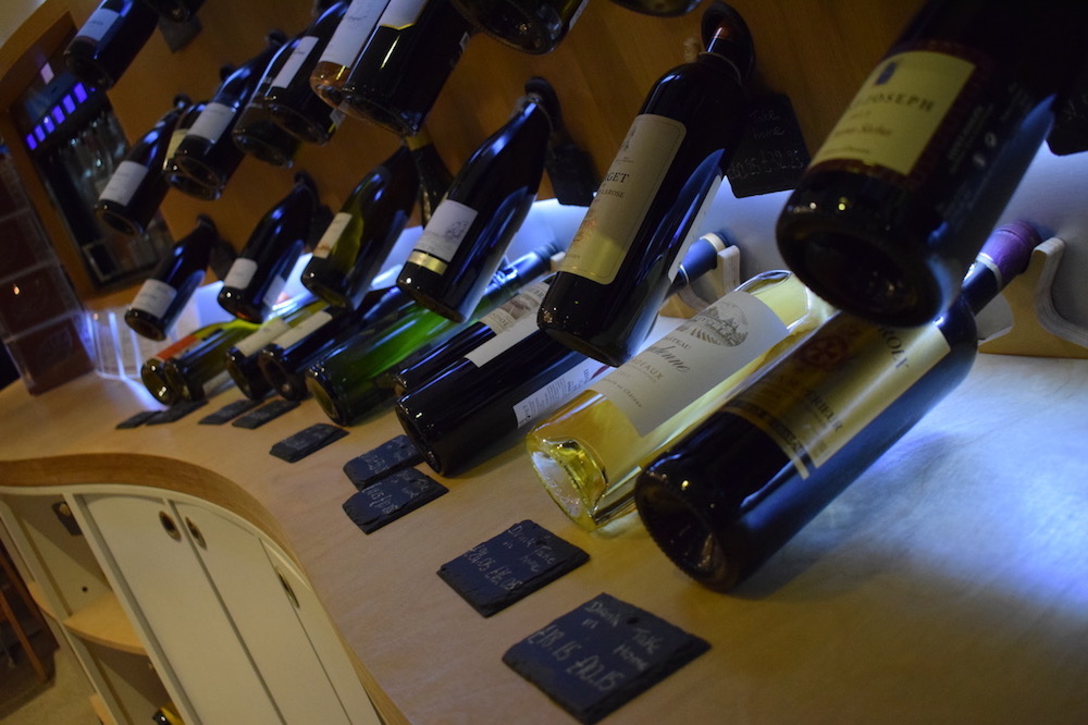 wine bottles on display at le vignoble wine lounge in plymouth devon