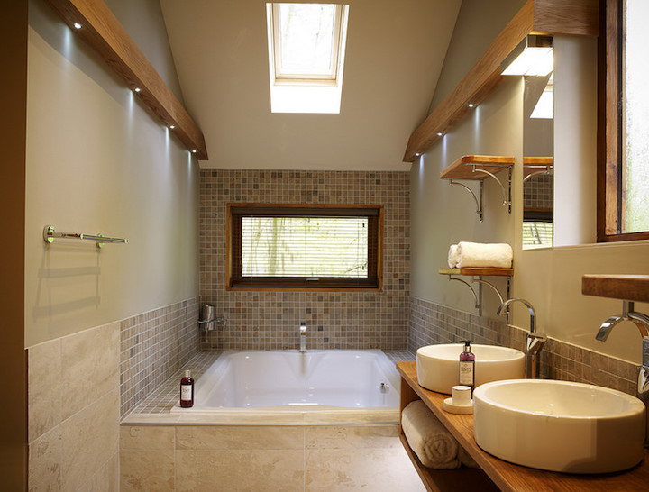 interior of log cabin bathroom with double sink and jacuzzi bath