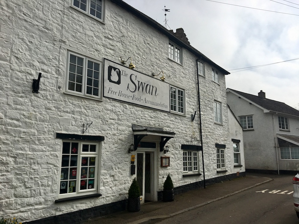 exterior of whitewashed pub the swan