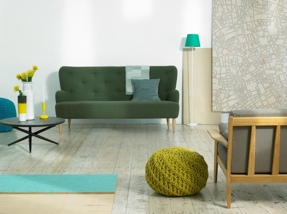 interiors green knit pouffe, green sofa, coffee table with selection of vases