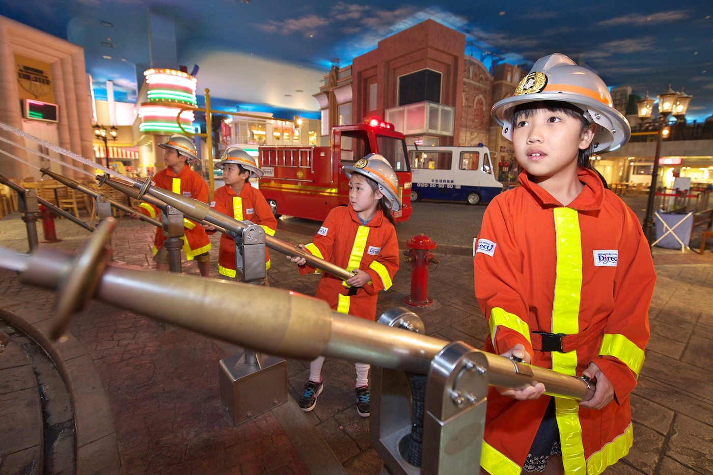 young children in firemen's kit playing