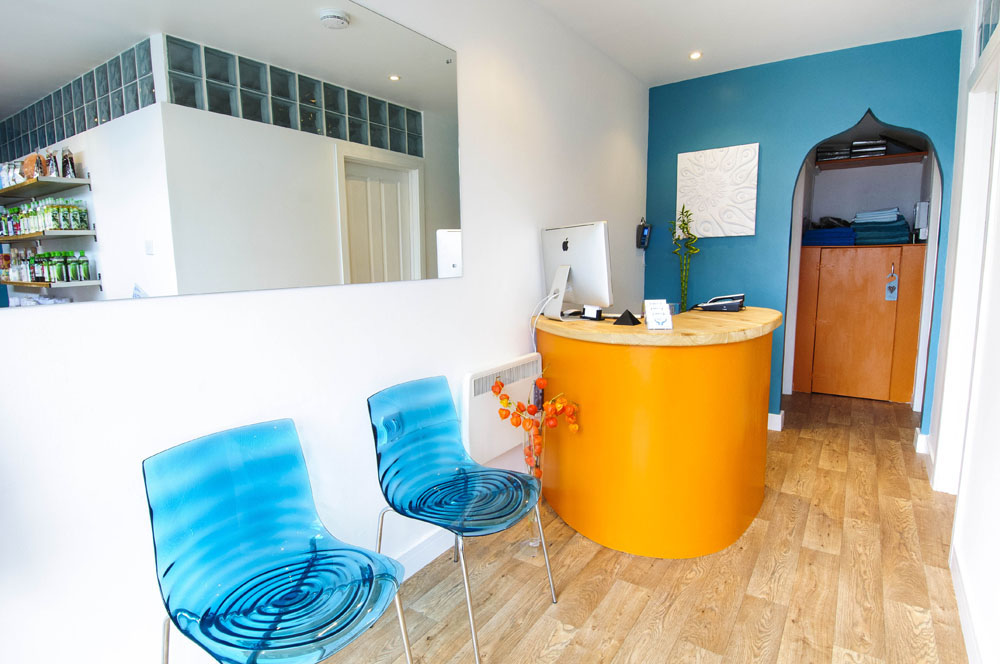 blue perspex chairs against white walls