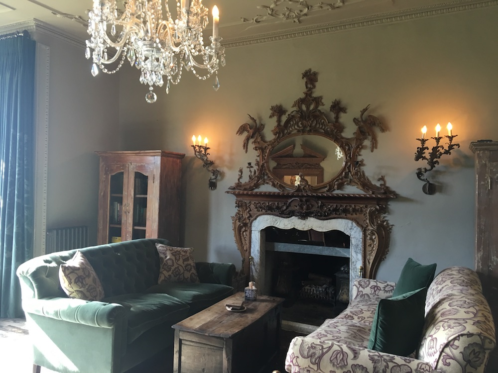 sofas, fireplace, chandeliers, the pig hotel combe