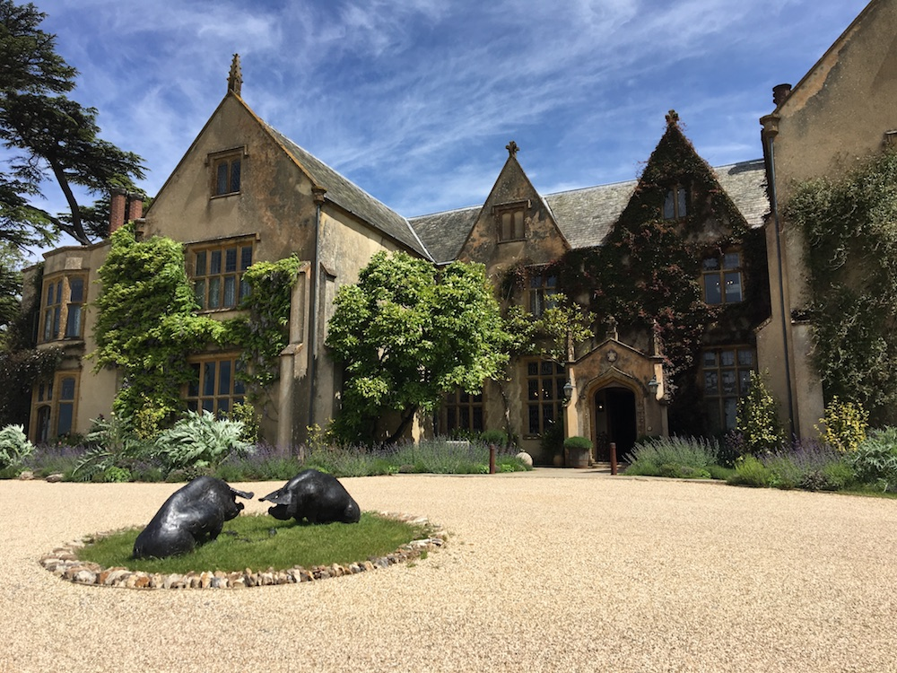 The Pig exterior Elizabethan country house with black pig statue