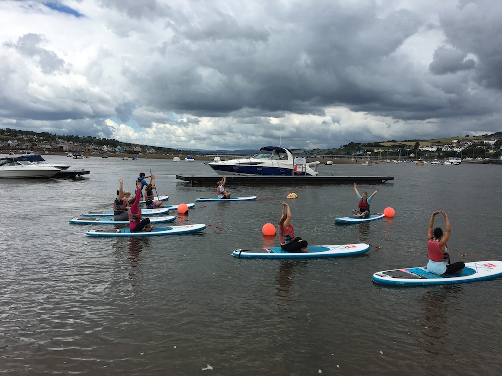stand up paddleboard yoga back beach teignmouth