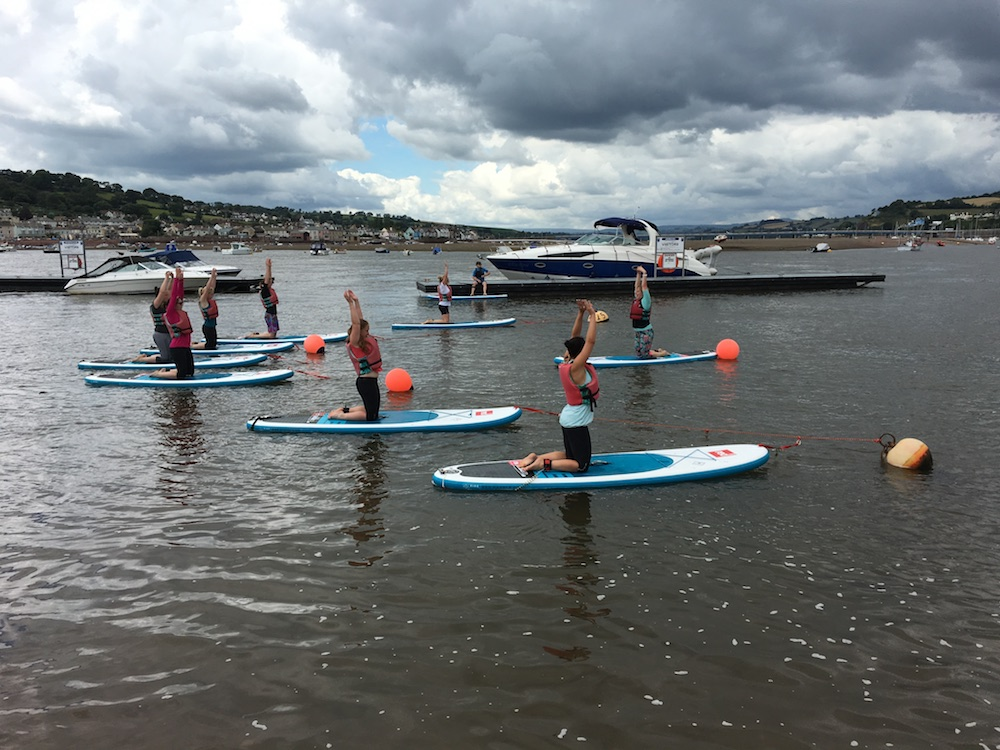stand up paddle board yoga back beach teignmouth