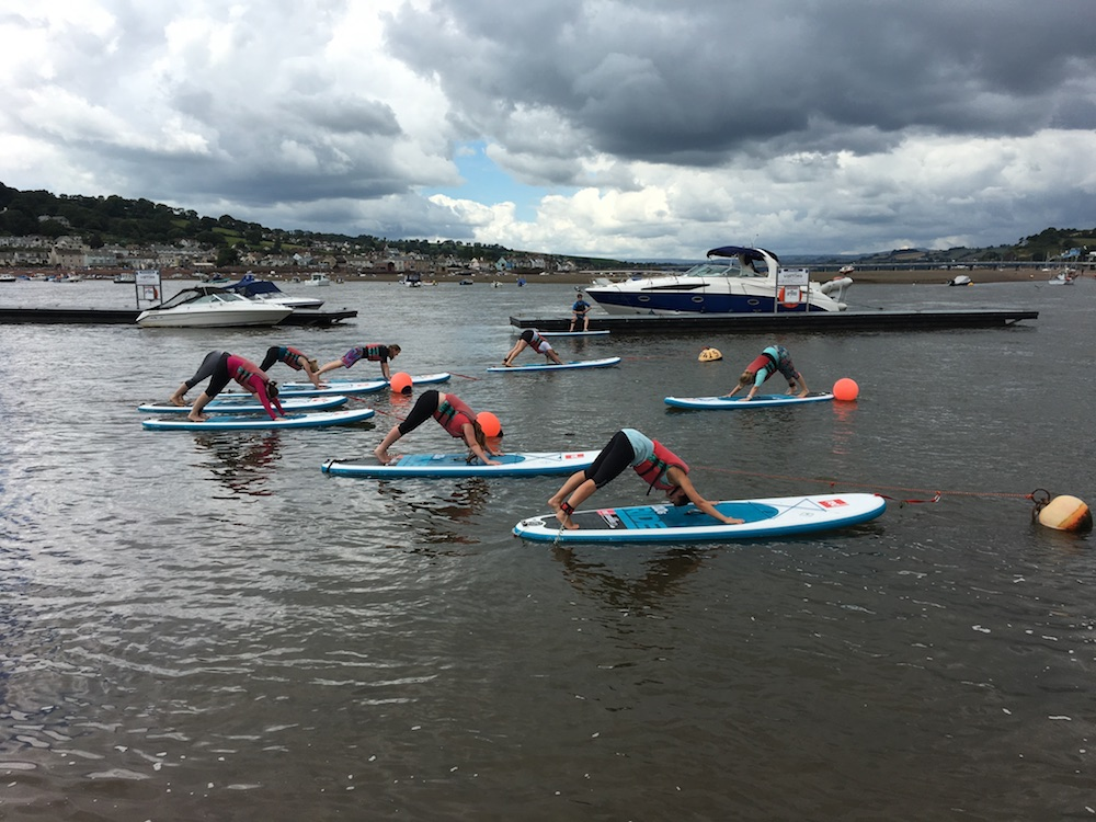 stand up paddleboard yoga on back beach teignmouth