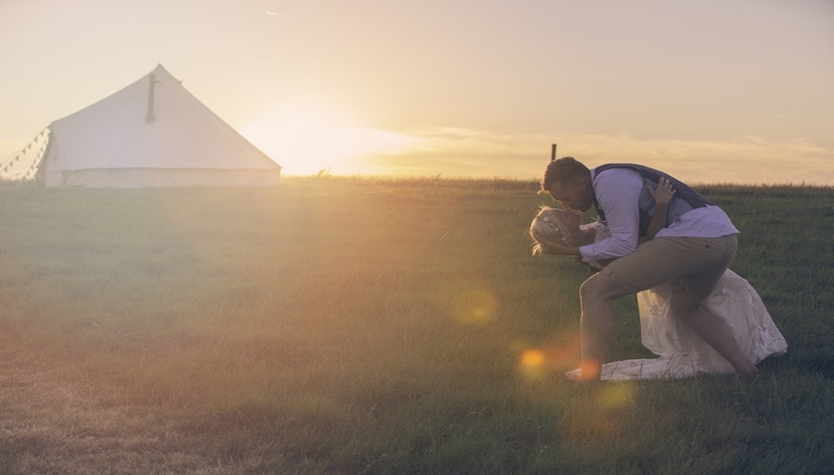 bride and groom bell tent sunset