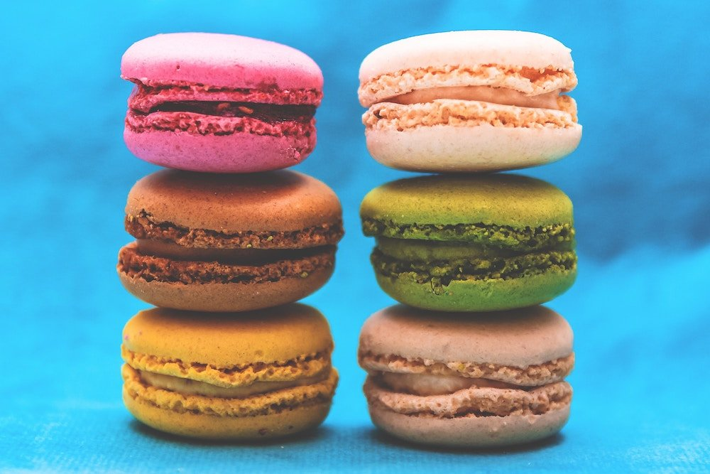 coloured macarons on blue background