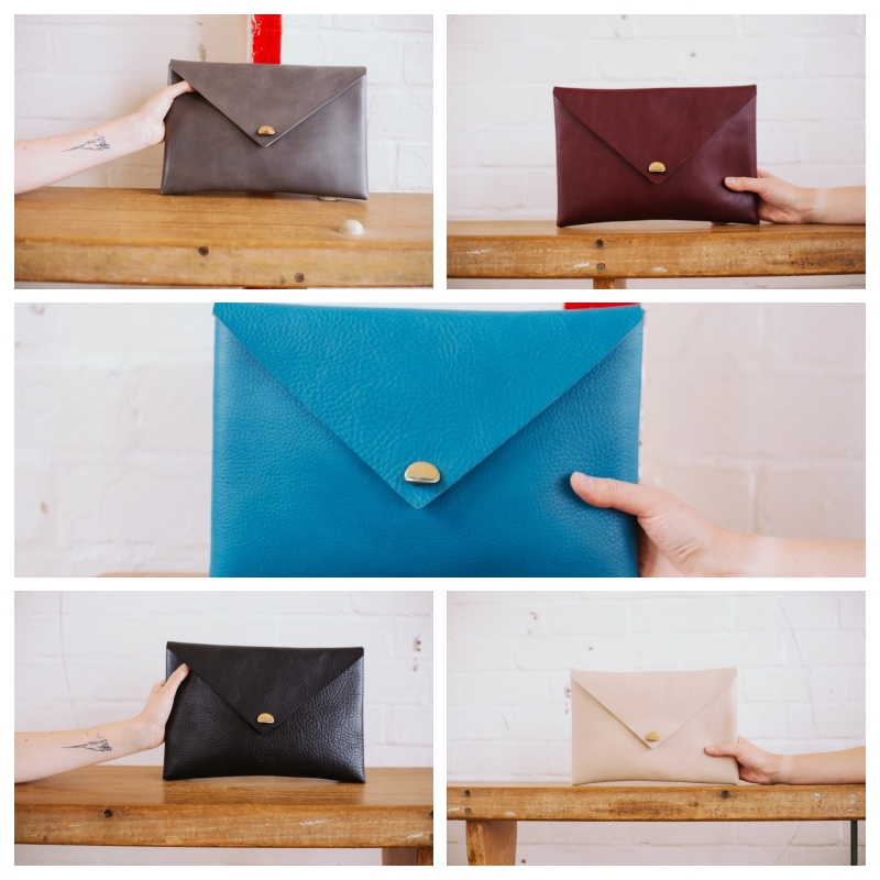 leather clutch bags in slate, sloe, jay, black and linen colours