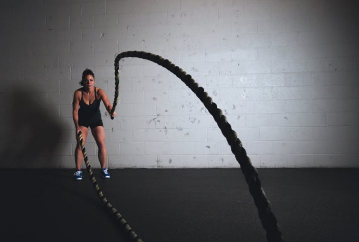 woman rope lifting in gym