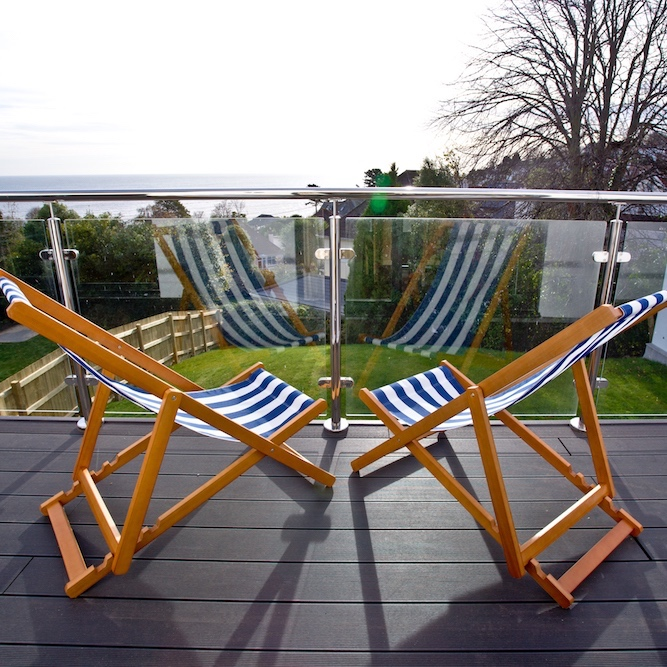 Striped deckchairs on sun terrace looking out to sea