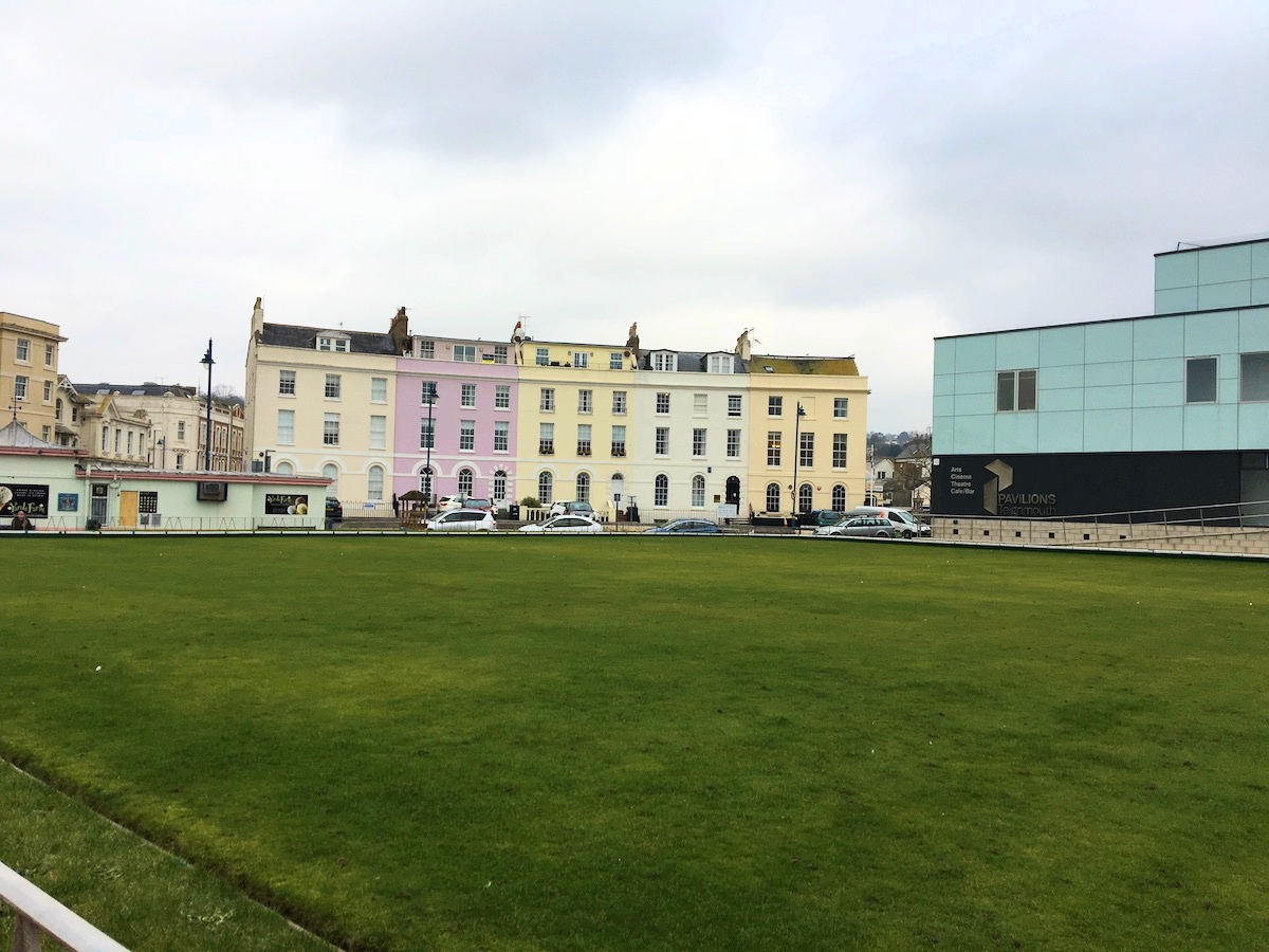 pastel coloured georgian buildings grass green