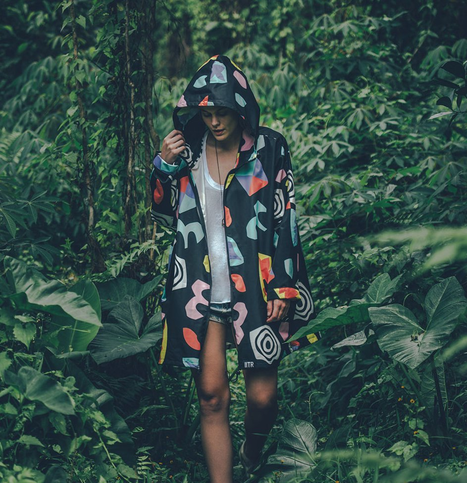 woman in colourful raincoat in forest