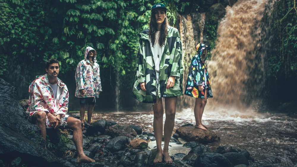 women in colourful raincoats in forest