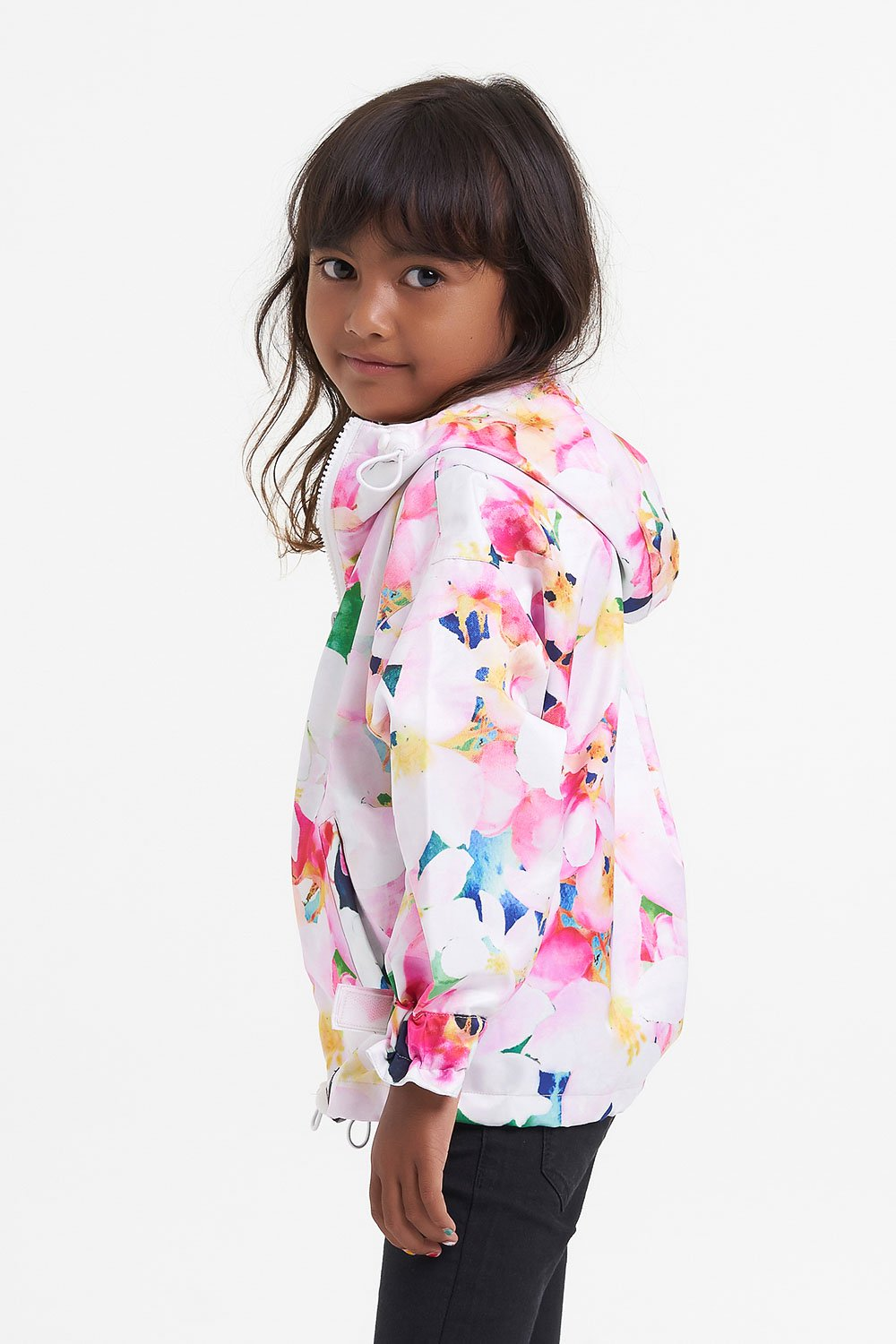 little girl in pink patterned raincoat