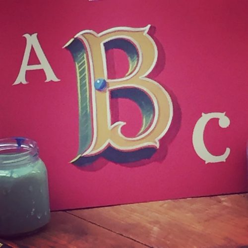 sign letters on red board