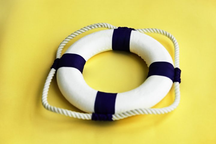life ring against yellow background