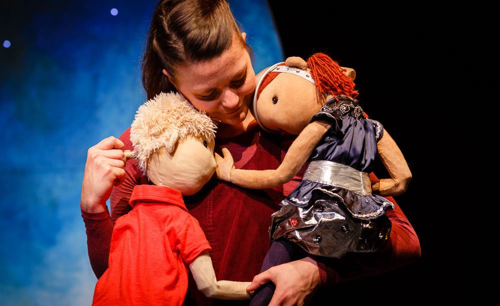 Puppets and girl on stage