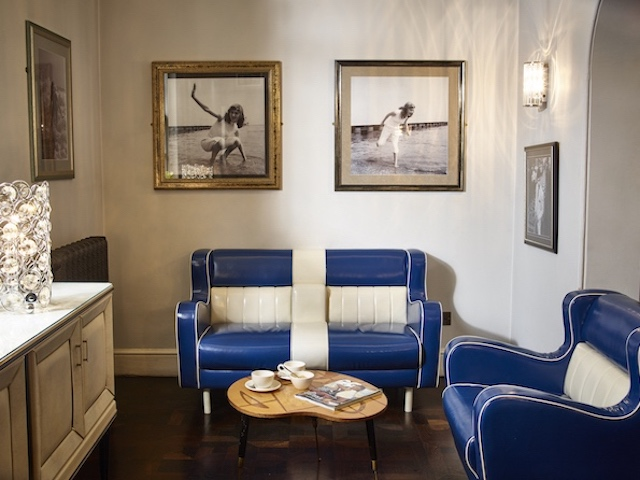 retro blue leather sofas paintings