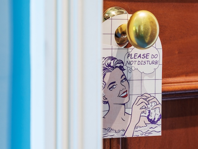 do not disturb sign with woman on retro