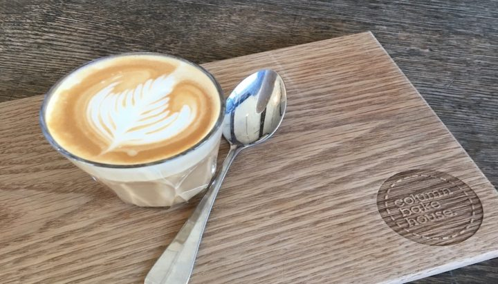 Coffee in a glass latte chopping board spoon
