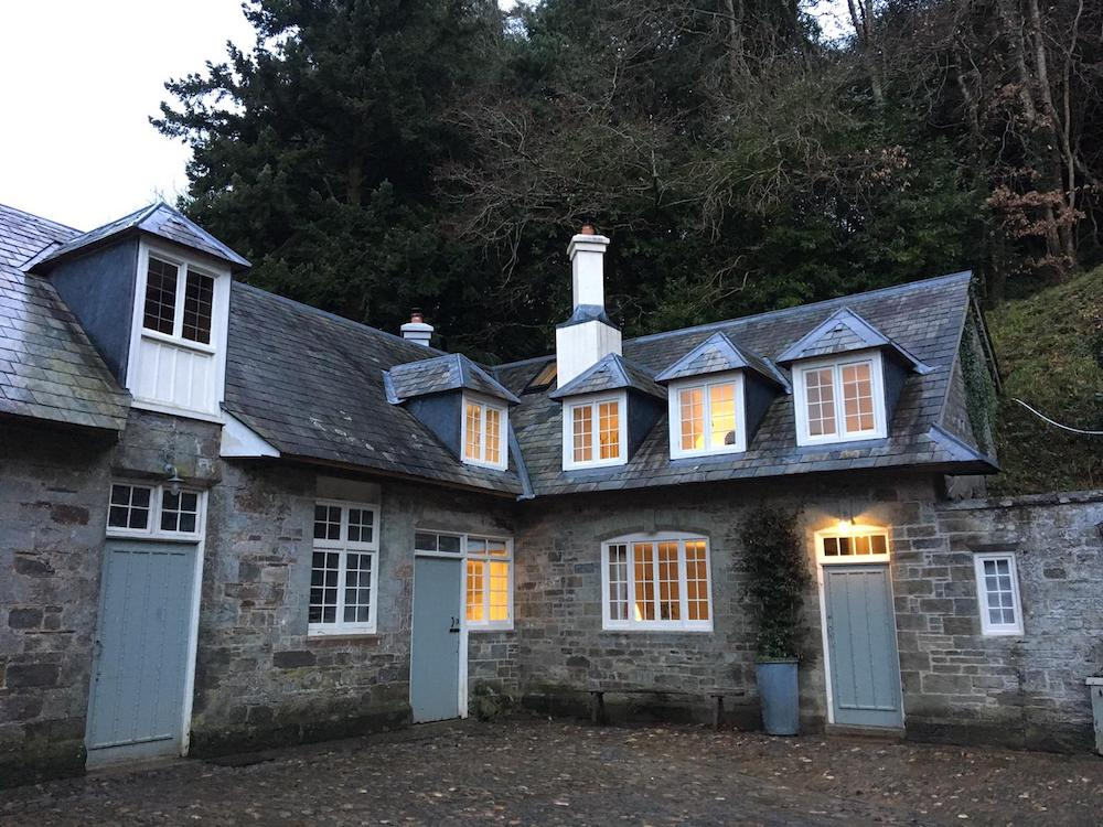 old stable converted exterior with lights on