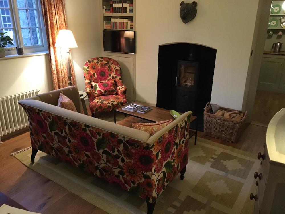 flower patterned sofa fireplace