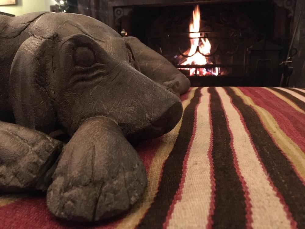 stone dog by fire