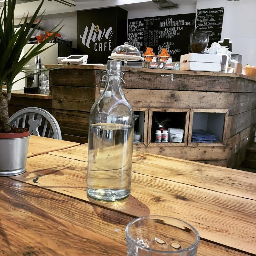 coffee shop interior wooden table glass water bottle