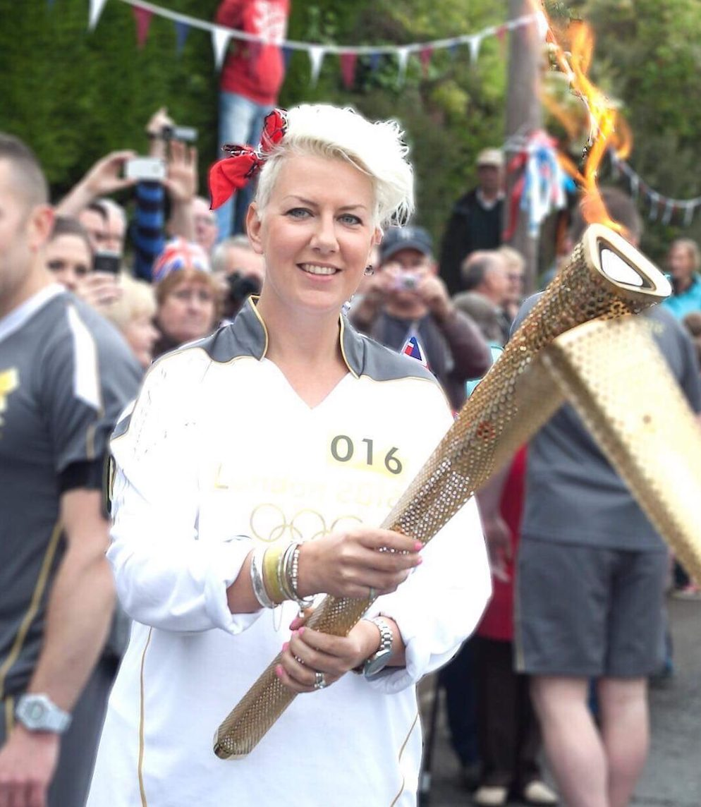 Woman holding Olympic torch