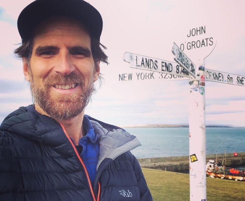 man with beard at john o'groats sign
