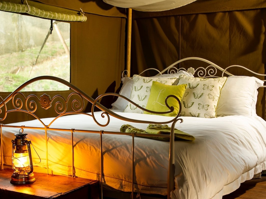 kingsize bed in safari tent