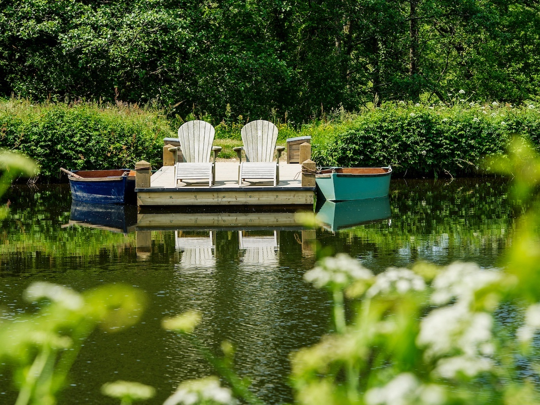 boating lake with wooden chairs