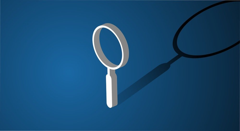 magnifying glass on blue background