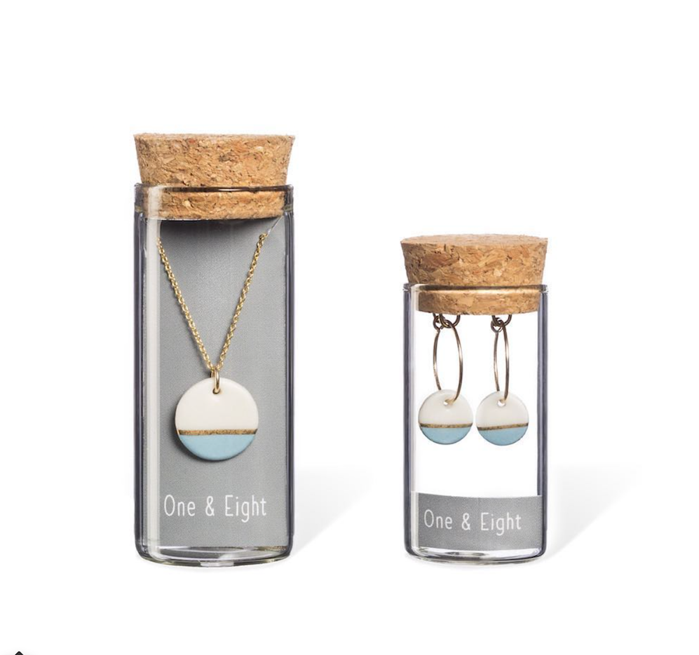 necklace and earrings in glass bottles
