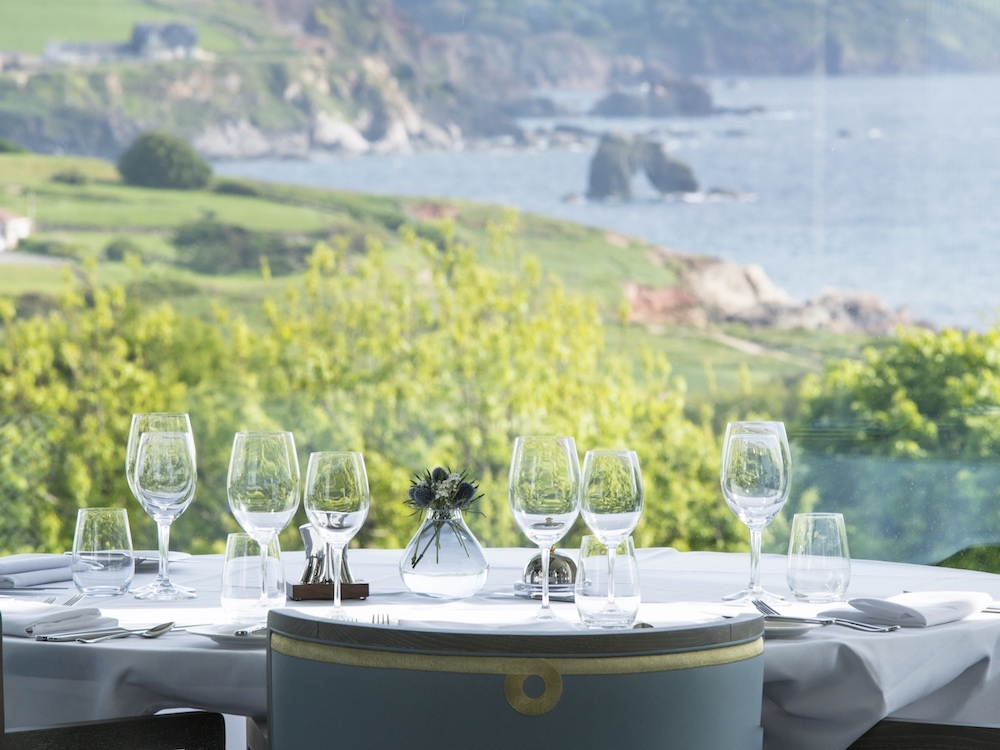 dining table with sea view in background