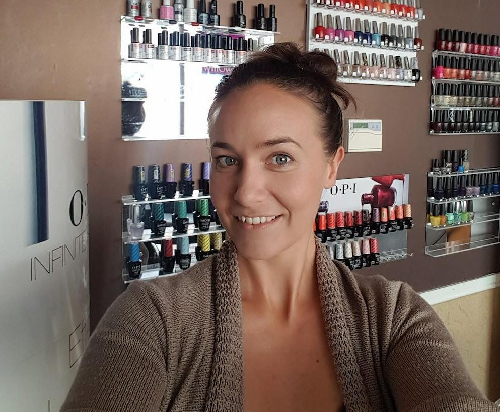 woman in front of nail polishes