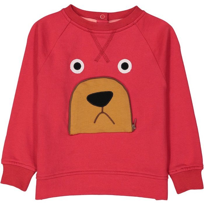 red jumper with bear