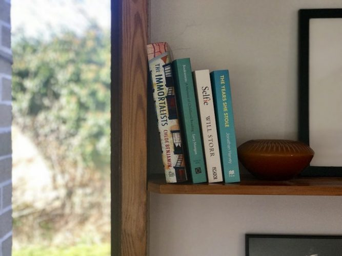 books on a wooden bookshelf
