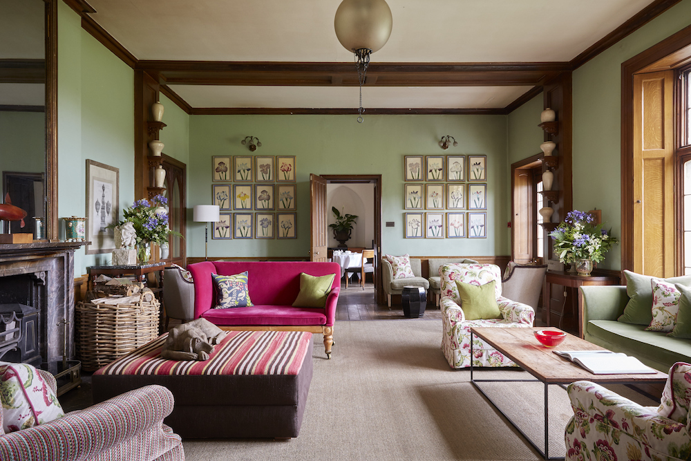 drawing room pink sofa paintings green walls panelled ceilings