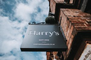 harrys sign against blue sky