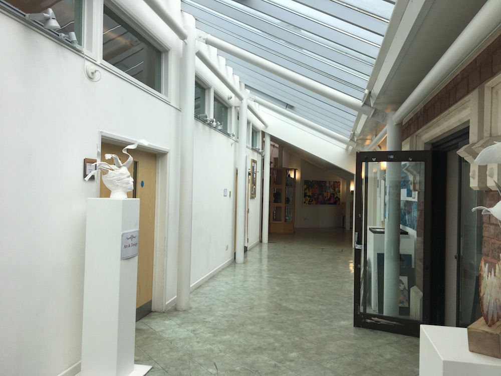 interior modern school corridor with glass ceiling