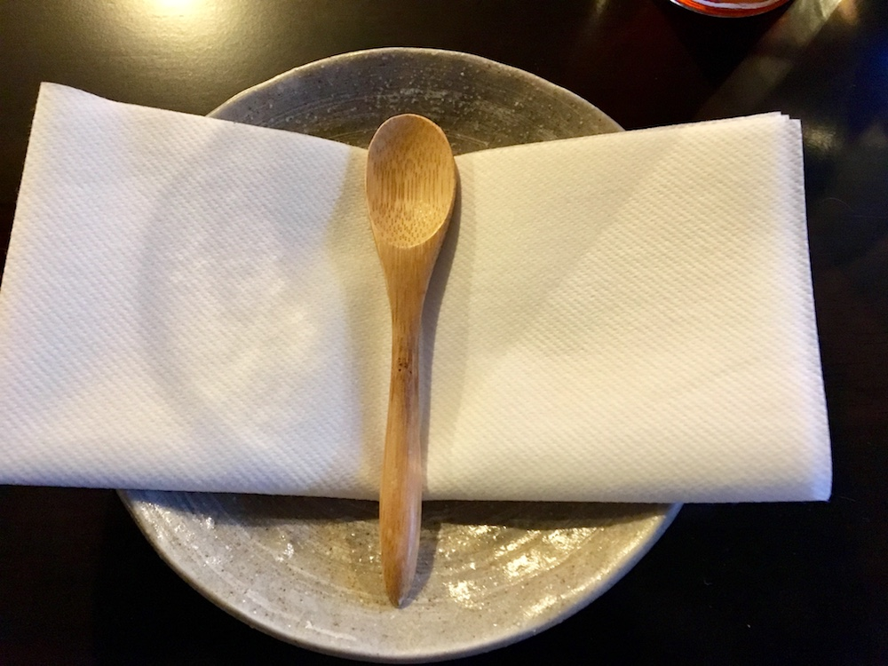 plate napkin wooden spoon