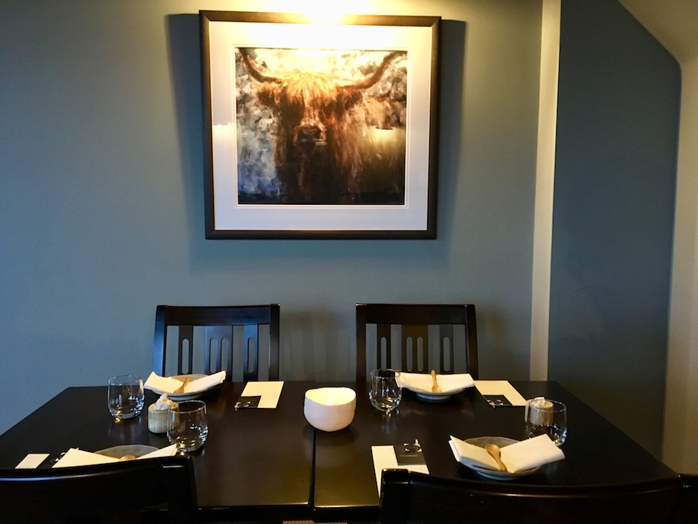 restaurant table picture of cow and blue walls